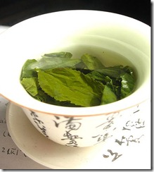 http://upload.wikimedia.org/wikipedia/commons/c/cb/Tea_leaves_steeping_in_a_zhong_%C4%8Daj_05.jpg