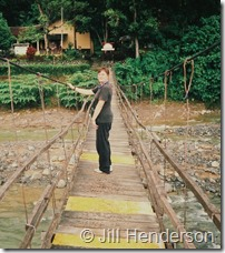 The author on the temporary swing bridge over the Bohorok River, Bukit Lawang.