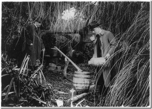 Image of Agents destroying a still in San Francisco during Prohibition. Image via Wikimedia; No copyright; Public domain image.
