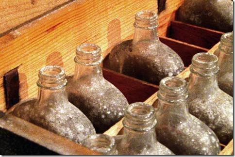 Old whiskey bottles. Image via Morguefile.