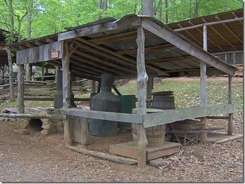 Whiskey still at the Museum of Appalachia in Norris, Tennessee, USA. The still was moved to the museum in the 1990s and was set up at the present site by famed moonshiner Marvin